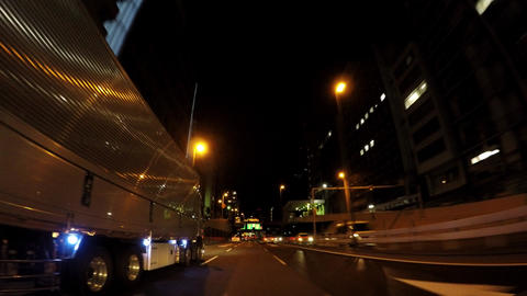 Japanese cityscape. Drive straight on the capital highway at night ビデオ