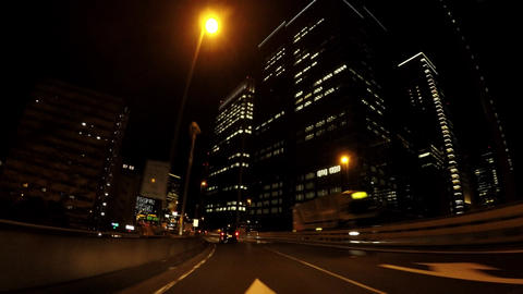 Japanese urban landscape, driving in Tokyo's night business district ビデオ