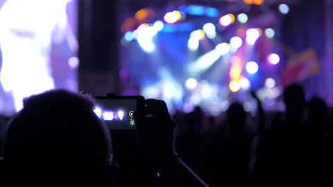 Man filming a concert Footage