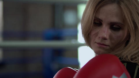 Woman in boxing gloves ready to hit Live Action