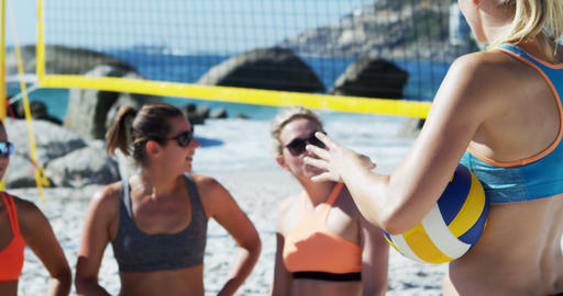 Female volleyball coach interacting with female players 4k Footage