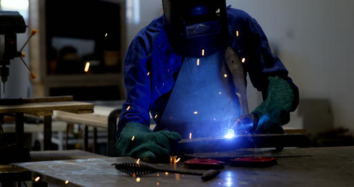 Female welder using blow torch on a rod 4k Live Action