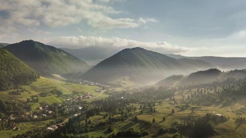 Morning flight above green rural landscape. Aerial Time lapse Archivo