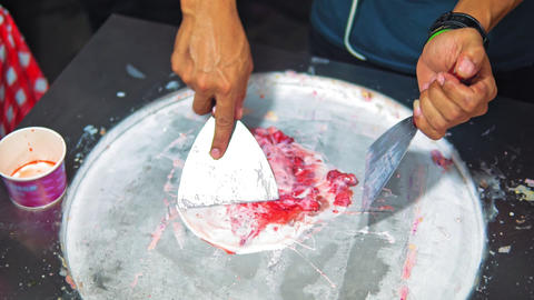 preparation of Asian street ice cream from natural ingredients. street food Footage