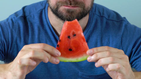 Bearded man eats a juicy watermelon Footage