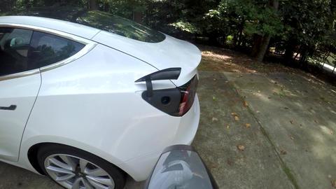 POV charging a Tesla Model 3 Live Action