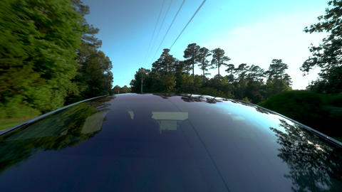 New all electric Tesla Model 3 driving down the road with a view from the glass GIF