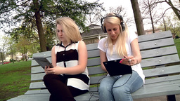 Woman Listens to Music in the Park Annoying Neighbor Footage