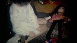 Vintage Film Girl Plays with Dolls Footage
