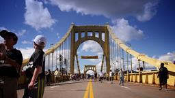 Pirates Fans Walk Across The Roberto Clemente Bridge stock footage
