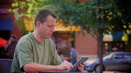 Man Reads eBook Outside 3621 Footage