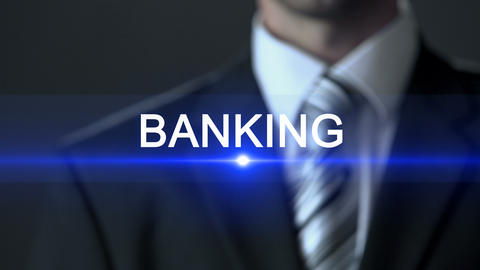 Banking, businessman in suit touching screen, financial sector, business concept Live Action