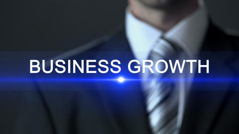 Business growth, man in formal suit touching screen, business concept, expansion Footage