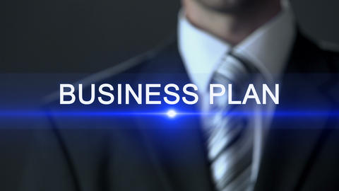 Business plan, male in business suit touching screen business development action Live Action