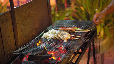 street food in Asia, traditional dishes on the night food market, seafood is Live Action