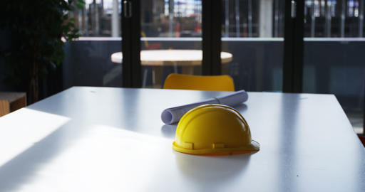 Blueprint and hardhat on a table 4k Live Action