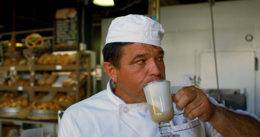 Chef drinking chocolate milkshake in the commercial kitchen 4k Live Action