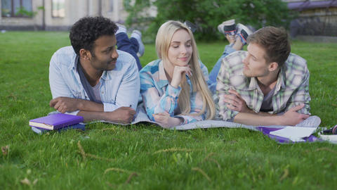 Charming blonde girl flirting with two guys choosing best one, relationship Live Action