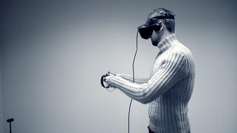 Man in a virtual reality helmet 영상물