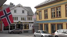 Europe Norway Karmsund Haugesund Norwegian flag & Pharmacy in old building GIF