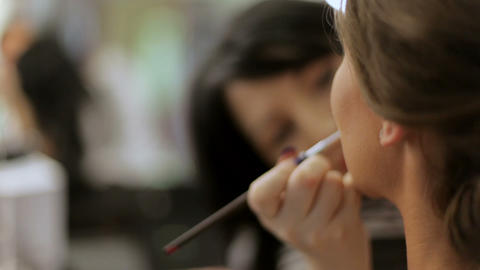stylist artist work in her studio. make-up artist works with a cosmetic brush Live Action