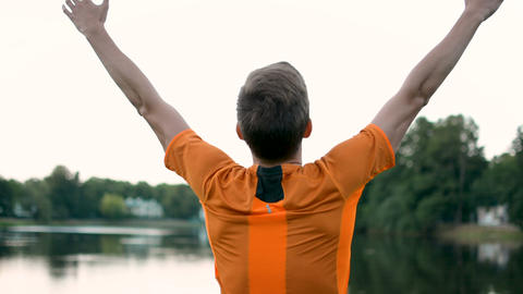 Raising hands in the air breathing fresh air after heavy workout outdoors Footage