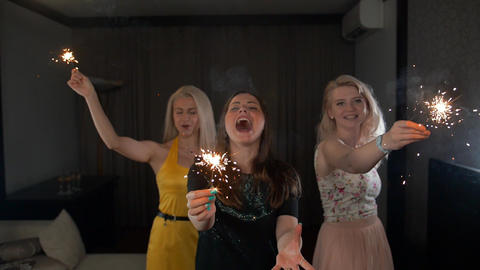 ladies happy dancing with sparklers Footage