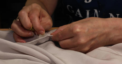 Woman with thimble sewing needle and thread white fabric Footage