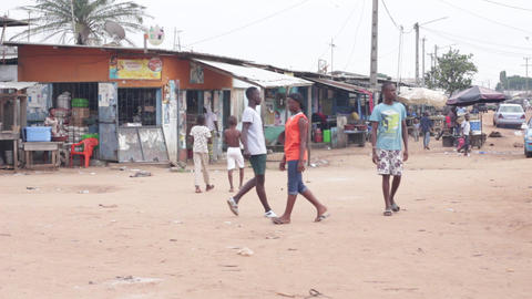 Young people strolling down the street separating the village Footage