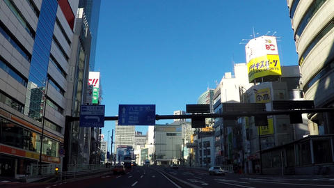 Japanese cityscape. The road between the train terminal station and the bus Footage