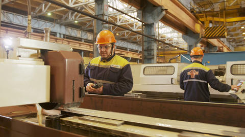 skilled worker operates with grinding machine at plant Footage
