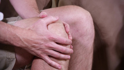 4K Aching Knee Pain Rub 3759 stock footage