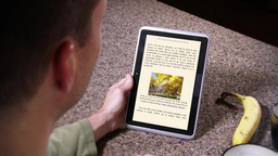 4K Man Uses eReader 3773 Footage