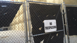 No Trespassing Sign on a Closed Fence Gate 4011 Footage