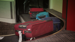 Luggage Arrives at the Baggage Claim Area 4044 Footage