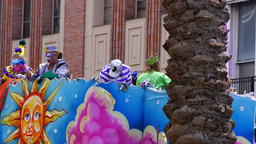 Throwing Beads from a Mardi Gras Parade Float 4092 Footage