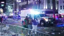 An Ambulance Clears the Street After a Mardi Gras Parade 4128 Footage
