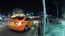 Time lapse of Seoul South Korea of a busy street at night with a traditional ビデオ