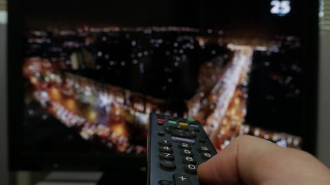 Using remote control to change tv channels Footage