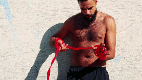 Boxer in the street before training - close up - actor arabic / latino Live Action