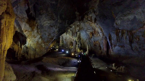 high cavern walls illuminated by powerful lamps Live Action