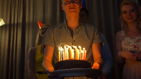 Happy male with friends bringing birthday cake to You Footage