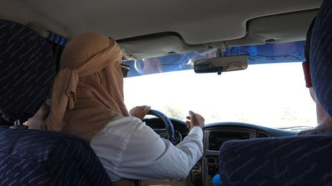 Tunis, Tunisia - 09 June 2018: muslim man driving on suv car view from rear seat ライブ動画