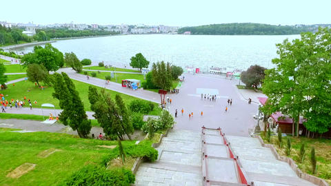 Beautiful views of the city, the promenade and the blue lake in the center of Footage