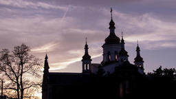 Time lapse Cinematographic mystical church in silhouette at sunset with clouds Footage