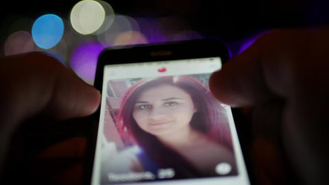 Use Tinder dating application for meeting new interesting people - smartphone Footage
