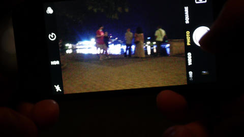 Taking photos at night with smartphone camera Footage