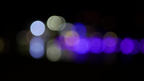 Cityscape out of focus at night - blinking defocused circles - bokeh effect GIF