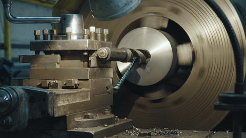 Milling Machine Produces Metal Detail on Factory Footage