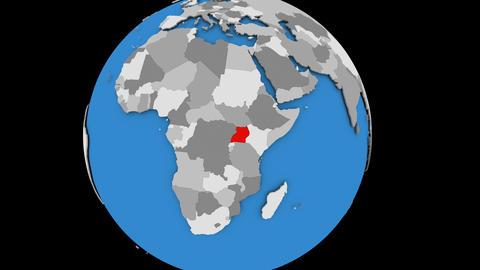 Zooming in on Uganda on political globe Animation